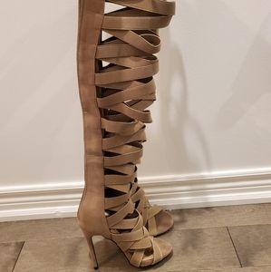 Thigh high gladiator sandals